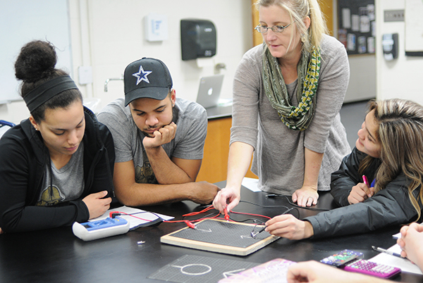 Physic students work on an experiment during lab.